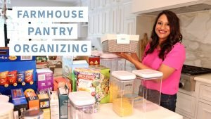 Amitha shows wicker baskets she uses to organize her farmhouse pantry