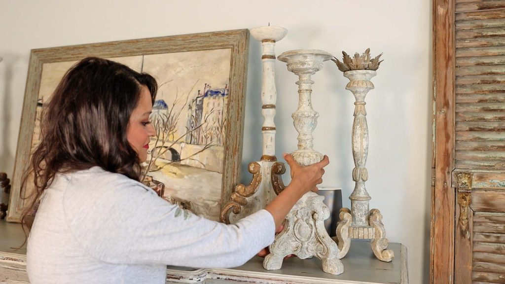 To bring in the feeling of early fall into her home, Amitha Verma adds extra vintage inspired candle sticks to the top of her dining room buffet.