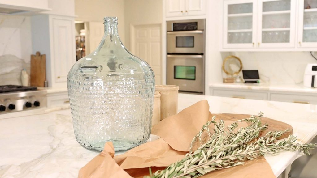 Amitha Verma uses oversized glass jars available at Village Antiques to decorate her home for early fall.