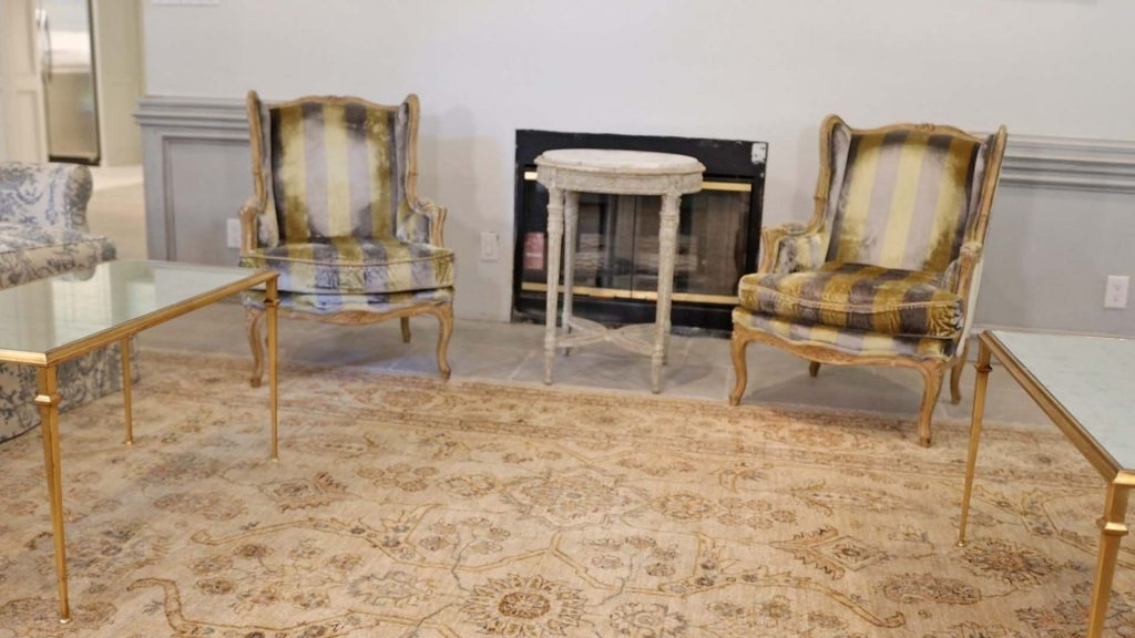 A pair of reupholstered antique chairs add character to Amitha Verma's family room by introducing functional and unique pieces of farmhouse furniture.