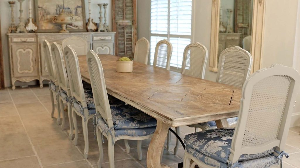 A large piece of farmhouse furniture that adds character to Amitha Verma's home is her antique dining table.
