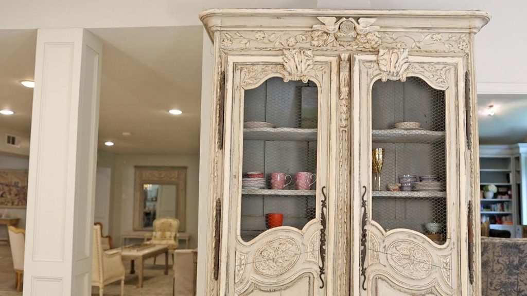 Amitha Verma uses a free standing antique cabinet in her kitchen in place of adding additional built-ins to add character to the space.