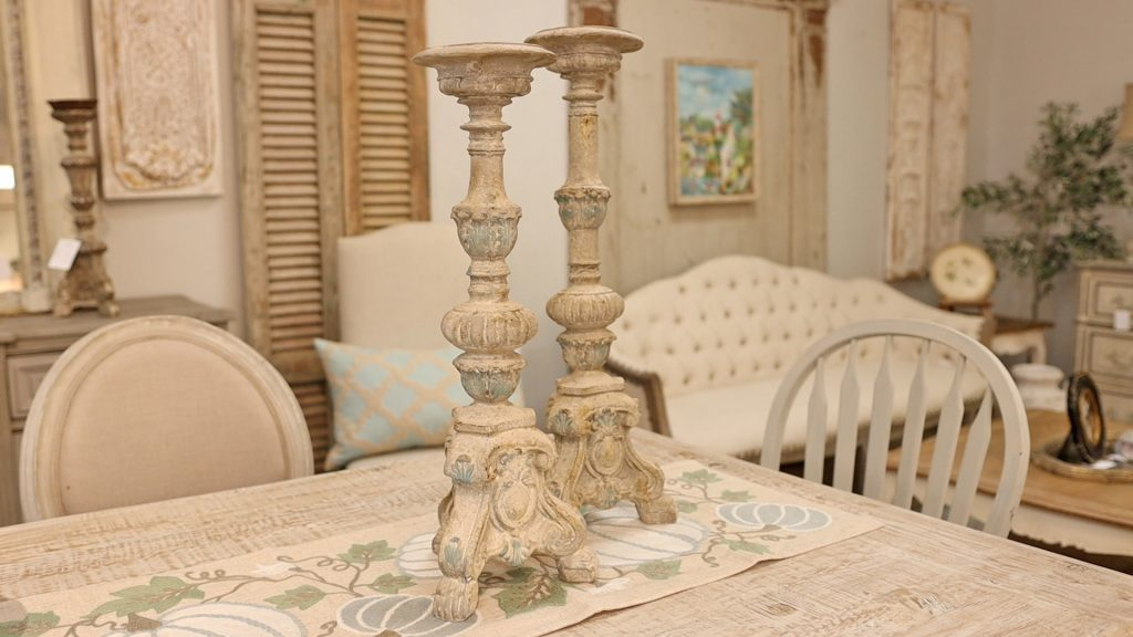 Amitha Verma adds tall chippy candlesticks to her simple farmhouse fall table design to create varying heights.