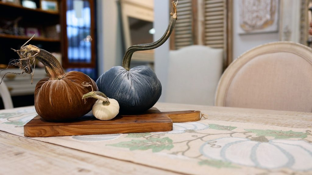 Velvet pumpkins in brown, blue, and cream add to the colors that Amitha Verma is using in her simple farmhouse fall table makeover.
